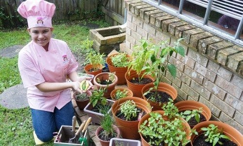 Kid Chef Eliana in the Herb Garden July 2014